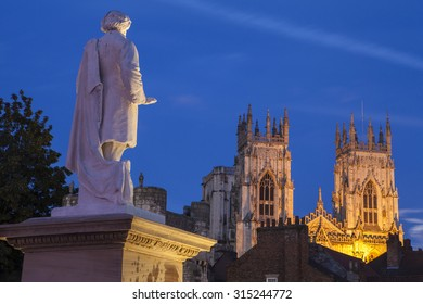 An evening view of the William Etty statue and York Minster in York, England.