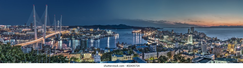Evening Vladivostok from the height, panoramic views of the Golden horn Bay and the Golden bridge
