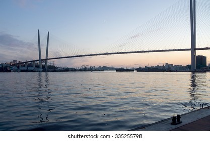 Evening Vladivostok. View from the Quay on the Golden Horn and the bridge.