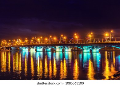 Evening Voronezh city, Russia. Illuminated Chernavsky bridge with reflections in water on Voronezh water reservoir at night.