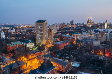 Evening Voronezh cityscape from rooftop. Contrast between old and modern buildings