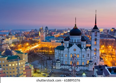 Evening Voronezh cityscape. Tower of management of south-east railway and Annunciation Cathedral at sunset background