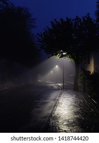 Evening walk through a foggy European city, a mystical and fabulous picture photographed on a smartphone