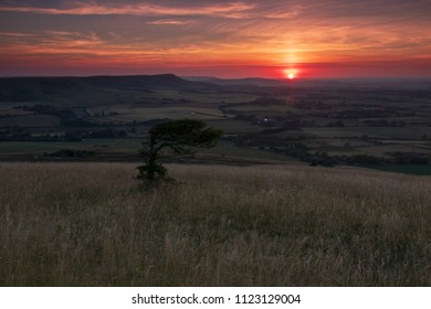 An evening walk up Wilmington Hill in east Sussex to catch a moon rising and sun setting over the south downs south east England