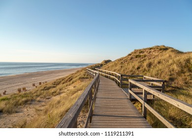 Evening at Wooden promenade with View to Kampen Beach at Sylt / Germany