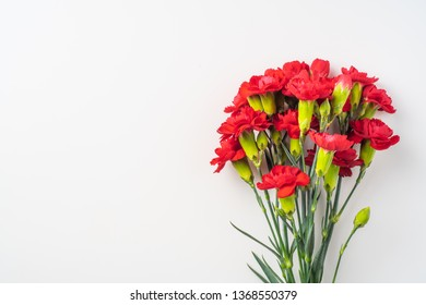 event design concept - top view of a bunch of red carnation isolated on white background for mothers day and valentines day, wedding event with copy space for mock up