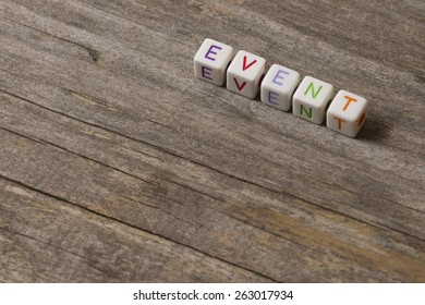EVENT word on a wooden background
