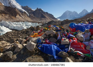 EVEREST BASE CAMP, NEPAL, 20 October 2018 - View from Mount Everest base camp, tents and prayer flags. A lot of tourists on a popular treck.  Sagarmatha national park, trek to Everest base camp