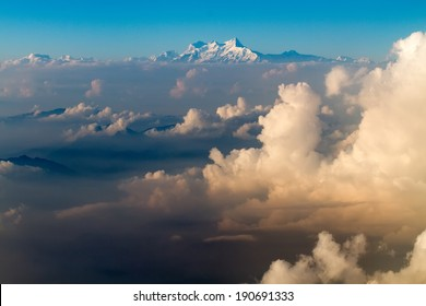 The Everest mount aerial view from plane over cloud sea before landing in Kathmandu in Nepal