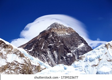 Everest. Sagarmatha. Summit of Mount Everest with white cloud around formed by high altitude jet stream wind. Highest mountain in the world, photo taken from Kala Patthar, Nepal side.