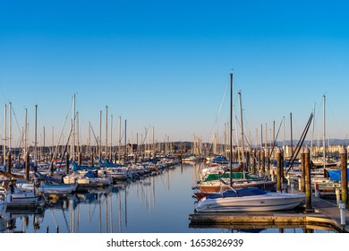 Everett WA. - USA / 02/19/2020: Boat mooring at Port Gardner bay in the late afternoon sun.