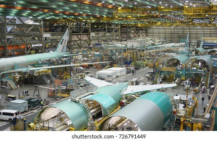 EVERETT (WA), USA – JANUARY 30 2015: Unidentified Boeing employees continue work building its latest Boeing 777 jets at its Everett factory.