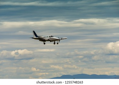 EVERETT, WAS, USA - JUNE 2018: Cessna 340 twin engined light aircraft with wheels and flaps down coming into land at Everett.