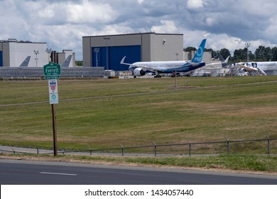 EVERETT, WASHINGTON - JUNE 20, 2019: Boeing 777X aircraft with folded wing tips after completing its first taxi test at Paine Field.