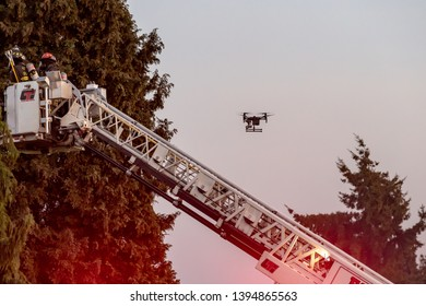 Everett WAshington, USA / 05/09/2019 - House Fire Fireman Try To Contain Fire on Roof on old Ballon Frame Home as a drone records the action