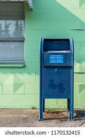 Everett, Washington / USA - 08/29/2018:  United States Post Ofiice Mail Box in the afternoon sun