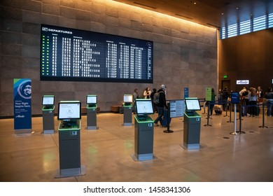Everett, Washington / USA - May 25 2019:  Ticketing and check-in atrium at the new Paine Field Airport, with modern ticket kiosks and departure board