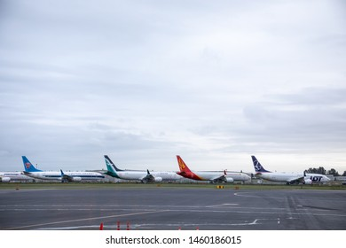 Everett, Washington / USA - May 25 2019: Row of brand new Boeing 787-Max 8 Airplanes parked along the tarmac at Paine Field, in an aviation background with space for text