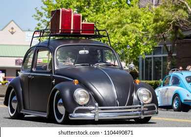 Everett, Washington, USA, May 30, 2018. luggage on the roof of an old VW Bug. Car doing the Crusin Colby event.