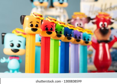 Everett, WA/USA - January 17, 2019: General view of Funko products featuring Hanna Barbera character Huckleberry Hound including limited edition colored PEZ dispensers, POP toys, cereal and soda.