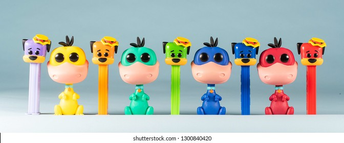 EVERETT, WA/USA - January 17, 2019:  General view of limited edition color Funko Huckleberry Hound PEZ dispensers and Flintstones Dino Funko POP.