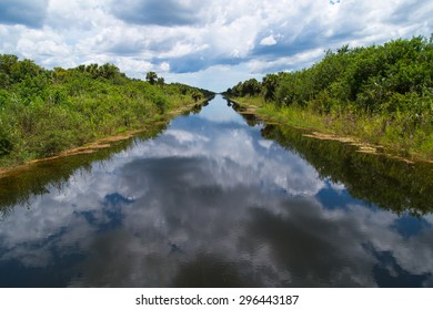 Everglades Canal with Sky Reflection