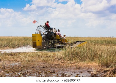 Everglades National Park, Florida. June 07, 2015. Group of tourists riding an airboat in Everglades National Park