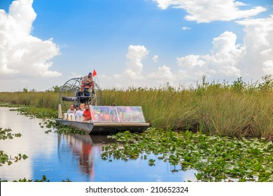 EVERGLADES, UNITED STATES - August 10, 2014: group of tourists riding an airboat. The Everglades are a natural region of wetlands in the southern portion of the U.S. state of Florida.