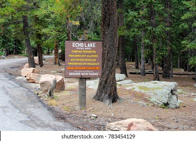 Evergreen, CO, USA - August 24, 2017: Small square sign at Echo Lake Picnic area listing restrictions and hours. Rules of Echo Lake Park picnic area on a path sign outside