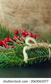 evergreen tree twigs and Christmas decorations on wooden background, copy space. Beautiful Christmas background.