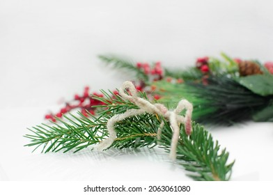 evergreen tree twigs on white background, Christmas decorations and copy space