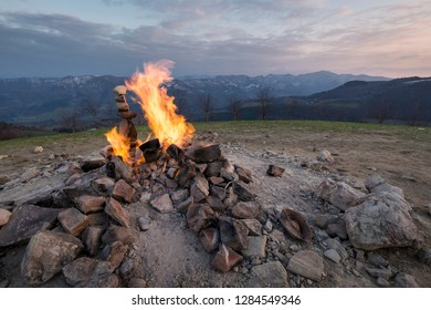 everlasting flame, neverending fire at Monte Busca volcano, mountains in the background