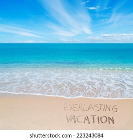 """""""everlasting vacation"""" written on a tropical beach"""