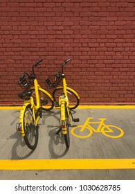 """Everton Park building, Singapore – February 4, 2018: rental by application two of """"ofo"""" brand bicycles parking in parking lot in front of Everton Park building, Singapore"""