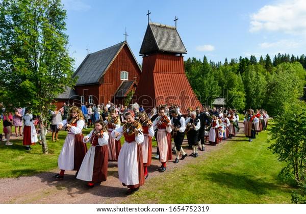 EVERTSBERG, SWEDEN -JUNE 21, 2013: People celebrating midsummer festival.