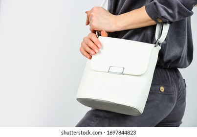every detail counts. woman looking stylish with bag. businesslady in stylish outfit. shopping and business. girl with flight clutch. wear elegant style. fashion model hold leather bag. copy space.