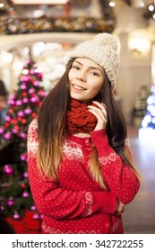 Every mall looks great during the Christmas holidays and everybody like to go shopping for presents.Attractive young shopper girl go shopping at the mall,buy holidays presents for New Year
