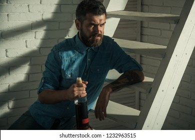 Every man needs some time for himself. Bearded man with bottle of wine. Handsome man wear beard and mustache. Man of fashion. Beard fashion trend. Barber shop or barbershop.
