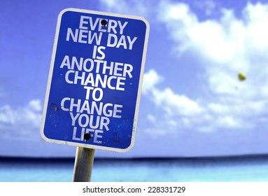 Every New Day is Another Chance to Change your Life sign with a beach on background