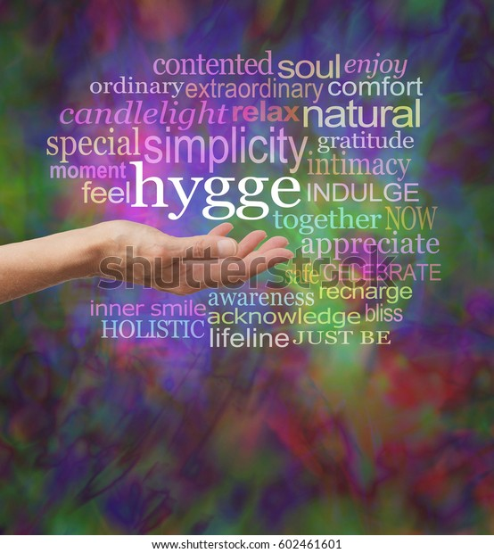 Everybody's talking about HYGGE - female hand outstretched with the hip Danish word HYGGE floating above surrounded by a relevant word cloud on a vibrant modern painterly background