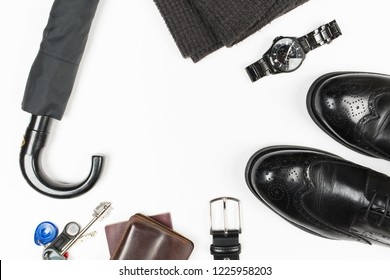 Everyday carry objects on white background. Keys, wallet, passport, wristwatch, umbrella, men's shoes. Top view. Space for text