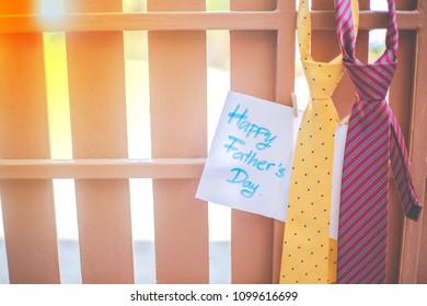 Everyday is father's day. Happy Father's day concept. yellow necktie, red necktie and the white paper written Happy Father's Day on the brown fence background.
