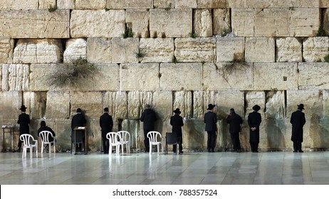 Everyday praying ceremony at the Western or Wailing wall, holiest Jewish site. Built in 20 BC by king Herod as retaining wall for Temple mount.