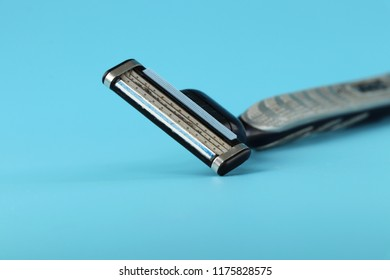 A everyday using tool in bathroom for man named razor blade. Blue background