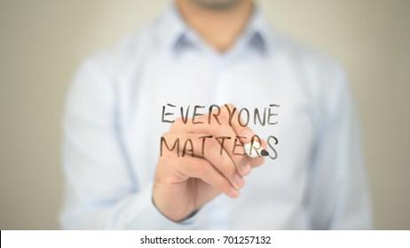 Everyone Matters, man writing on transparent screen