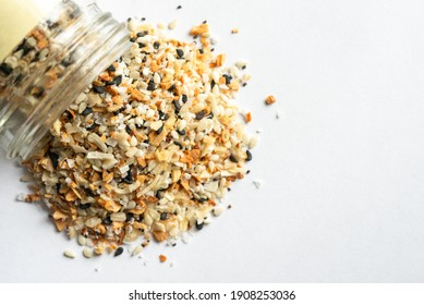 Everything Bagel Seasoning Spilled from a Spice Jar
