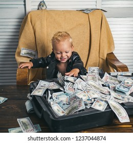 Everything looks great. Boy child with money case. Little boy count money in cash. Small child do business accounting in startup company. Startup business costs. Little entrepreneur work in office.