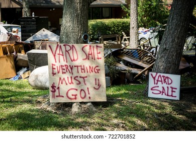 Everything must go yard sale in front of a Houston home devastated by Hurricane Harvey