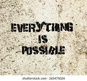 Everything is Possible tag graffiti painted on a concrete wall. Positive Thinking