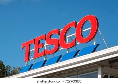 Evesham, UK - October 2017: Tesco supermarket sign atop a store exterior